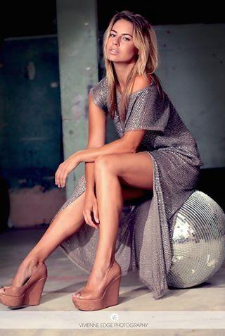 Model Kim mellor posing on disco ball