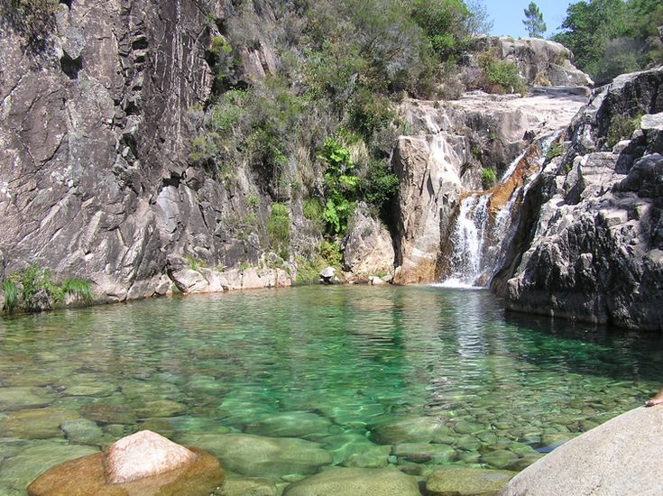 Peneda do Geres...it's located in North of Portugal (near to spanish border) and its in the countryside ! I love to be there, camping and swim in this pure, transparent water in the summer time ! :D