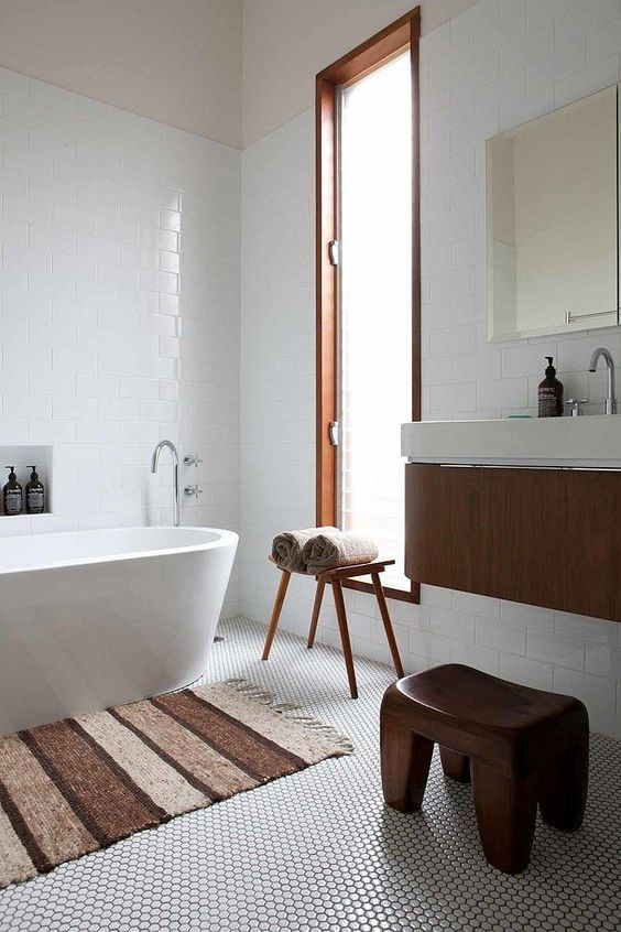 white penny tiles with black grout create a textural look