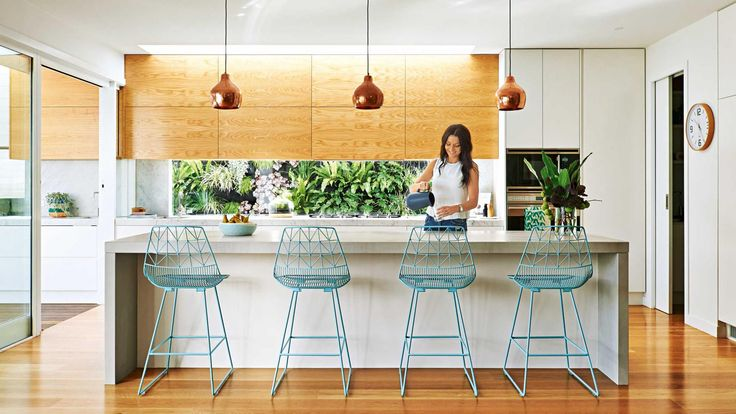 A '30s Californian bungalow in Victoria's Newtown renovated by Built By Wilson | white wood kitchen | concrete waterfall island | copper pendants | west coast