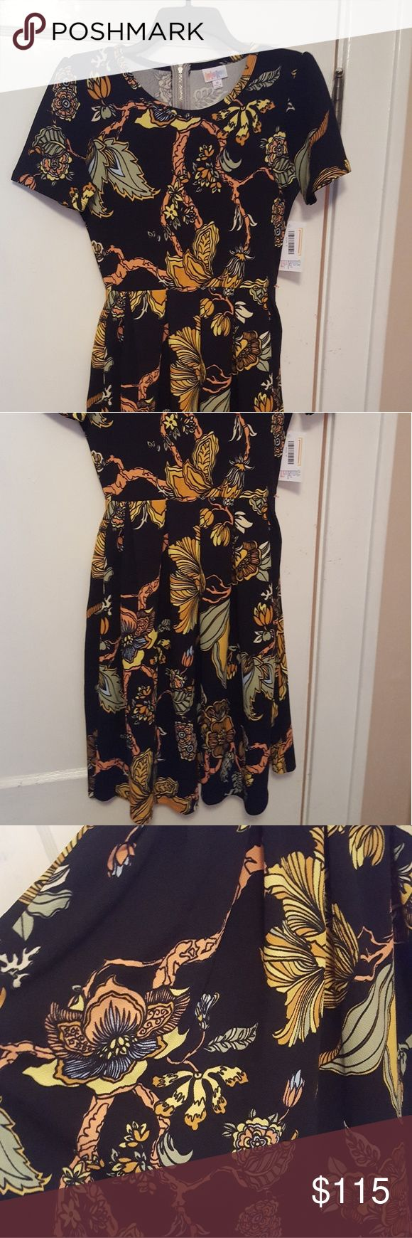 NWT UNICORN LULAROE Amelia floral dress M NWT lularoe Amelia navy blue dress in size medium. A line cut, pincess sleeves, full swing skirt and 2 slim slant hidden hip pockets. GORGEOUS floral pattern, luscious colors and Incredibly figure flattering.  Google the multiple ways to style these pieces- they are the PERFECT vacation item when traveling light! Each piece is unique. Any questions please feel free to ask :) I also offer combined shipping discounts on multiple purchases LuLaRoe…