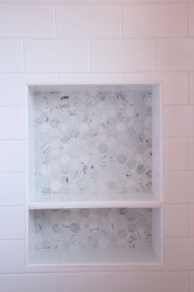 shower niche with hex marble tiles