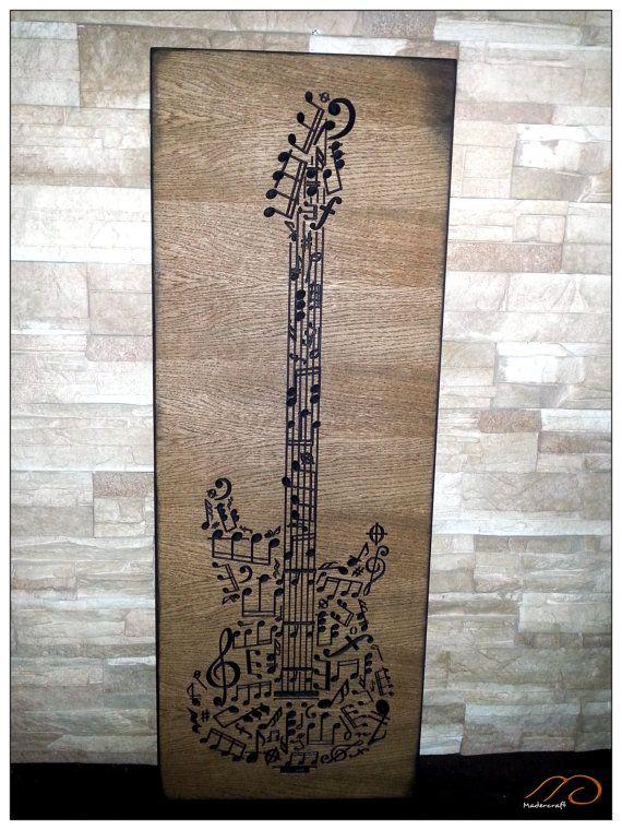 Cuadro de notas musicales dando forma a una guitarra eléctrica.