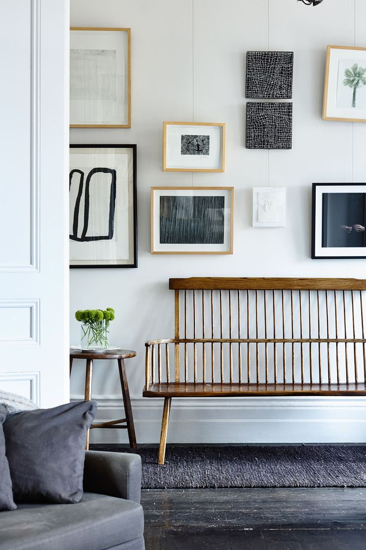 The bright white walls in the hallway are the ideal backdrop for artworks by…