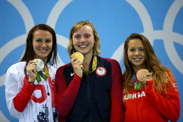 L-R) Sivler medalist Jazz Carlin of Great Britain, gold medalist Katie Ledecky of United States and bronze medalist Boglarka Kapas of Hungary celebrate on the podium after competing the Women's 800m Freestyle Final on Day 7 of the Rio 2016 Olympic Games at the Olympic Aquatics Stadium on August 12, 2016 in Rio de Janeiro, Brazil.