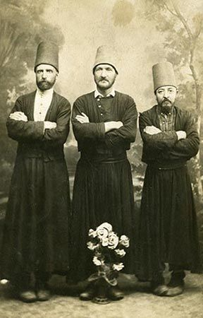 Three Mevlevi dervishes of the Yenikapı Mevlevihânesi (convent of Yenikapı).  Late-Ottoman era, end of 19th century.