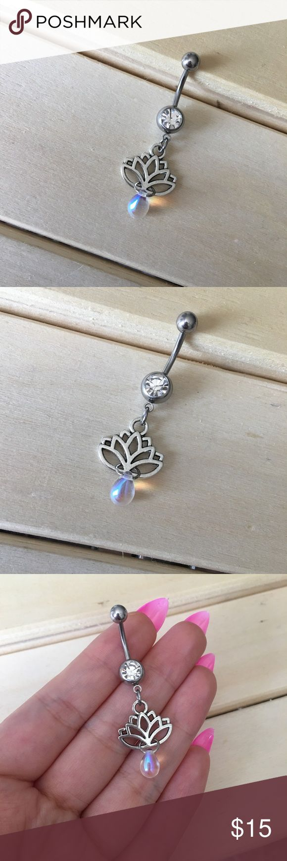 Iridescent Lotus Belly Button Ring Condition: Brand New Metal : Surgical Steel Size: 14 Gauge If you have any questions please leave a comment down below. Reasonable offers will be accepted I do not trade . -Belly Button Ring Navel Piercing 14G Surgical Steel Body Jewelry New- Jewelry Rings