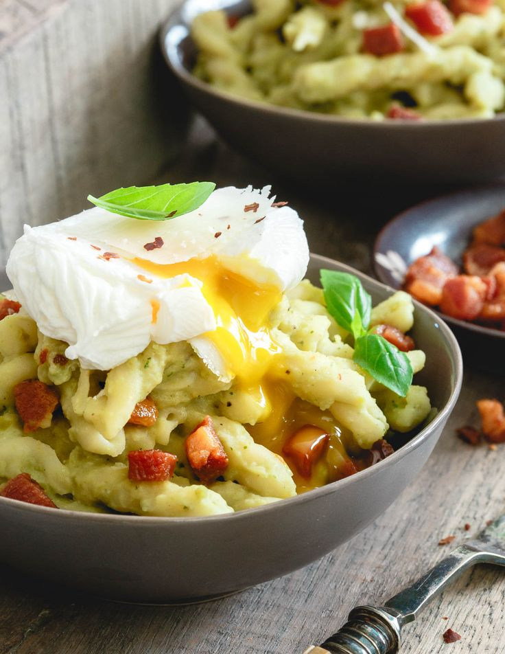 Split pea pesto pasta is made with chewy gemelli spirals, tossed with crispy skillet cooked pancetta and topped with a poached egg - total comfort food. | #HalfCupHabit #JustAddPulses #sponsored