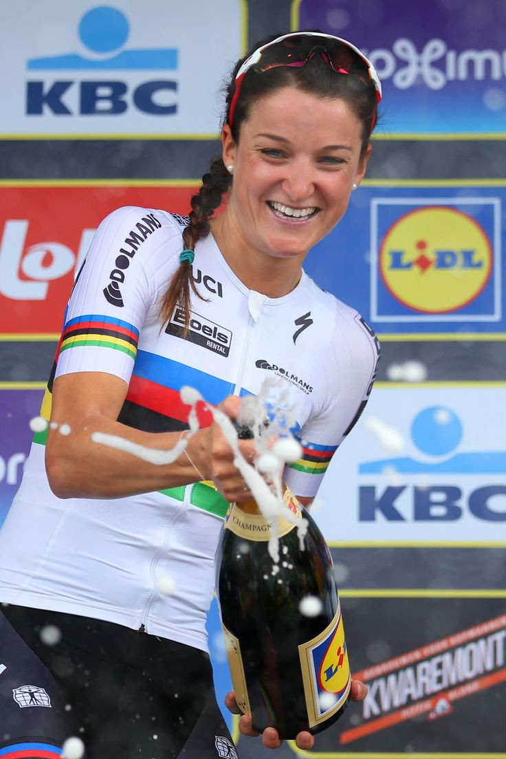 Race winner Lizzie Armitstead of Great Britain and Boels Dolmans celebrates on the podium during the 100th edition of the Tour of Flanders from Bruges to Oudenaarde on April 3, 2016 in Bruges, Belgium.
