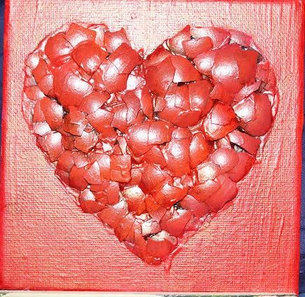 heart made of egg-shell on canvas