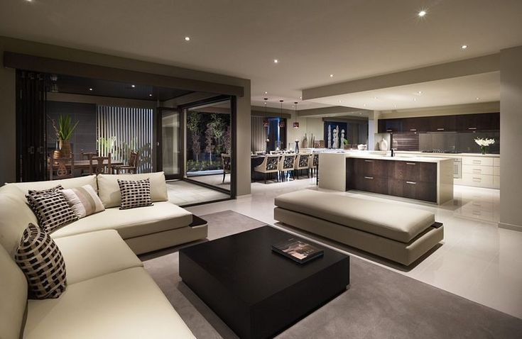 Open spaced living room leading into the kitchen. Beautiful!