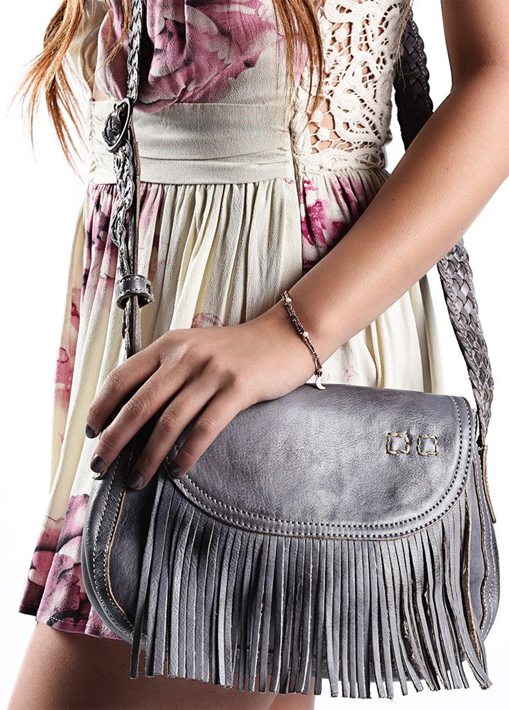 . The vintage inspired EASTEND bag boasts fringe and a braided strap. Its perfect for a music festival, or a day out with friends. The unique blue color is hand painted with toxic free dyes, and the leather is organic in the tanning process.