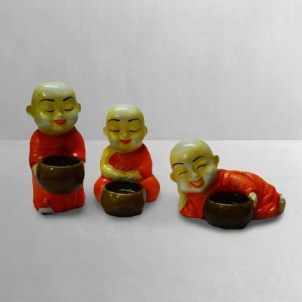 "#DiwaliDecor #FabFurnish Cute candle holders for this diwali from fabfurnish ""eCraftIndia 3 Monks Candle Holder"""