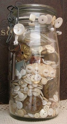 Mason jar filled with vintage buttons                                                                                                                                                      More