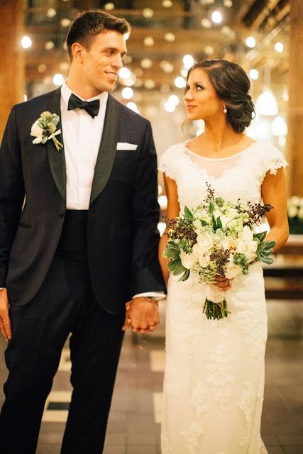 i like this old fashioned black and white wedding look. the dress is great and so is the tux.
