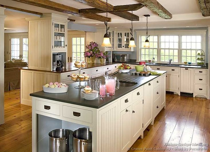 kitchen-cabinets-traditional-white-119-cp009a-island-sink-ceiling-beams-wood-floor