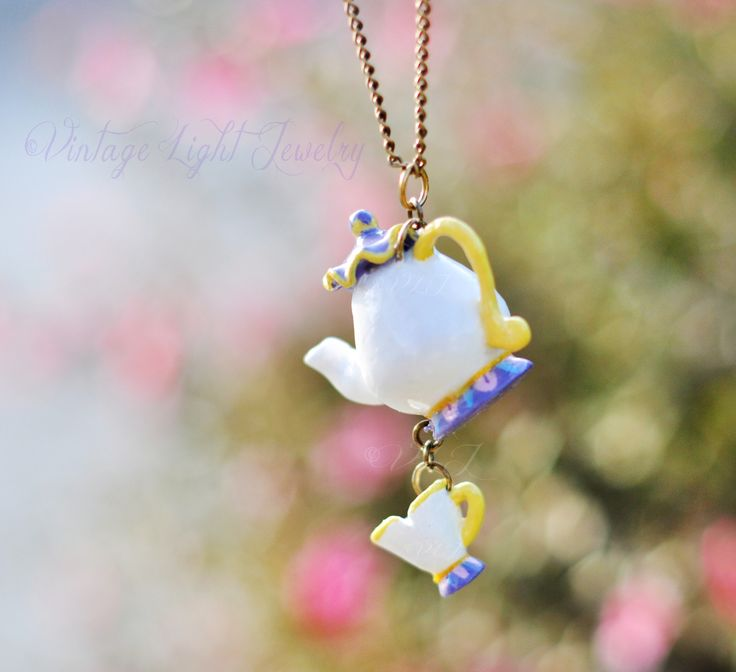 """vintagelightjewelry: """" Beauty and the Beast, Mrs. Potts and Chip inspired necklace. Made this what seems like a long time ago for an order. It is crafted out of polymer clay and painted with acrylics :) """""""
