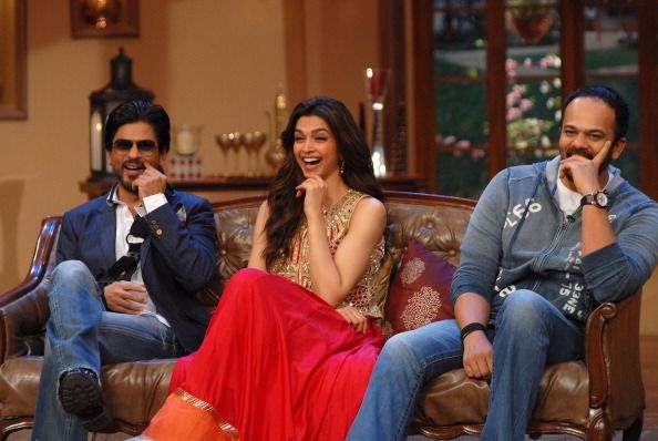 Bollywood actors Shahrukh Khan, Deepika Padukone and Director Rohit Shetty during the promotion of film Chennai Express on the sets of Colors TV Serial Comedy Nights with Kapil at Filmcity.