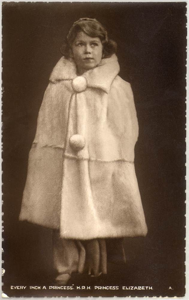 A 9-year-old Princess Elizabeth, christened Elizabeth Alexandra Mary, poses in an elegant winter coat.