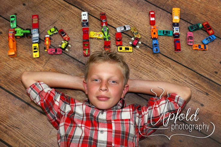 A really fun Christmas photo for a young boy - Ho-Ho-Ho with dinkie cars! Image by Upfold Photography, Auckland.