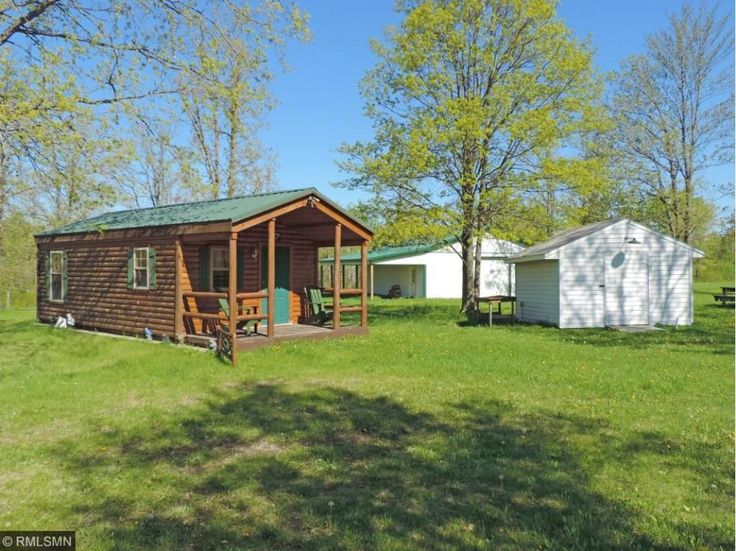 Great Hunting Cabin & Property! Tidy cabin with wood flooring, beautiful cabinets, 30 x 40 shop with carport.  Trails cut in, property is ready to set up deer camp.