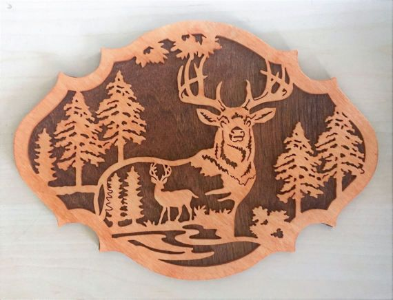 This deer nature scene is a wooden plaque to hang on your wall.  Get just this one for $40 or get a set of three for $100.