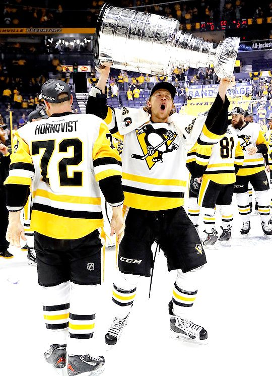 """lionelsmessi: """"""""Carl Hagelin #62 of the Pittsburgh Penguins celebrates with the Stanley Cup trophy after defeating the Nashville Predators 2-0 in Game Six of the 2017 NHL Stanley Cup Final at the..."""