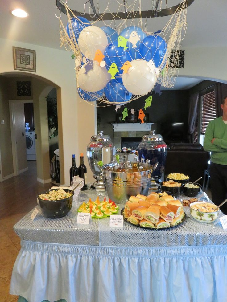 "A fishing theme party with My Big Day Events. ""The Big One""  http://www.mybigdaycompany.com/my-big-day-blog/a-fishing-themed-birthday-party-the-big-one Themed events with Colorado's Event Coordinators. #fishing #theme #party #food #ideas #creative #menu #decor #decorations #one #baby #toddler #birthday Kitchen buffet lake decor"