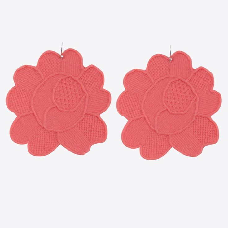 Handmade earrings made of non toxic waterproof silicone and a silver clasp. Jazzt Design find inspiration in their grandmothers' craft of hand knitting which is almost completely left behind nowadays. A contemporary interpretation of tradition as the silicone traces the hand knitted patterns in vivid colors. The old decorative doily acquires a new function.