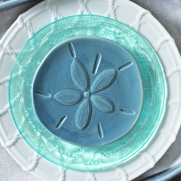 Pair white and blue glass dinnerware for a coastal beach feel.