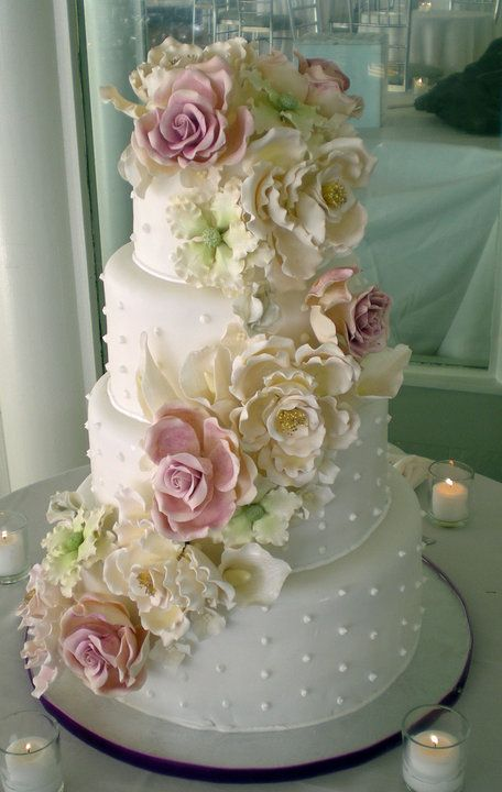 White cake with pale colored sugar flowers