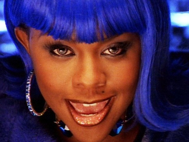 Lil kim would trailblaze the scene with colorful wigs and contact lenses