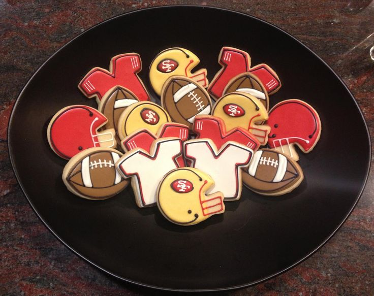 San Francisco 49ers Football Team Cookies by @AllWhippedUp using a Football Cookie Cutter, Jersey Cookie Cutter, and Football Helmet Cookie Cutter From The Cookie Cutter Company
