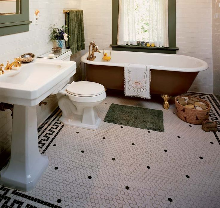 Small hexagon-shaped floor tiles are a bathroom standard; note the Greek key border in square mosaics.