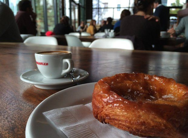 Roman Candle's kouign amann, a delectable, caramelized-sugar-topped pastry, and a Stumptown Coffee macchiato. (Michael Russell, The Oregonia...