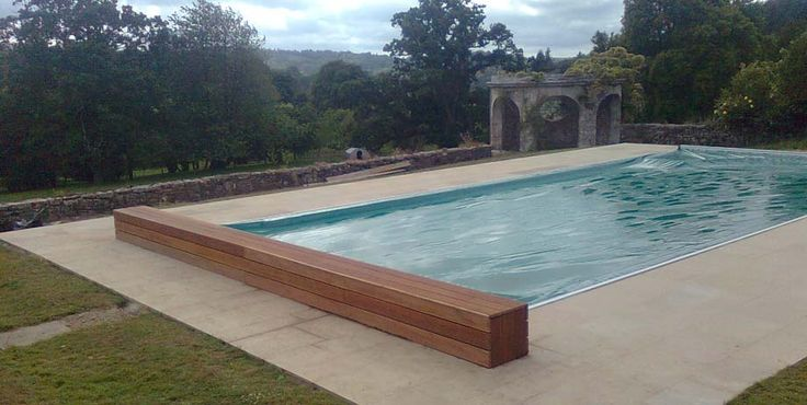 I can't afford an automated pool cover, but I CAN afford to buy a few bits of wood and make a box-cover for the normal pool cover. Great idea. #swimming #pool #landscaping #poolcover