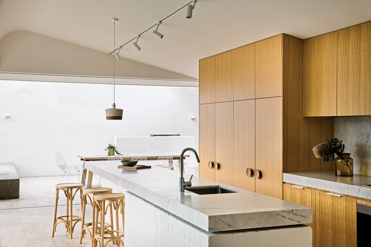 """Bold """"monumental geometry,"""" a muted palette and the integration of indoor and outdoor spaces have revitalized an old orange brick home in this addition by Kennedy Nolan."""