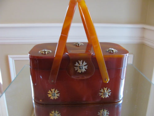Caramel Colored Lucite Purse Brass Medallions