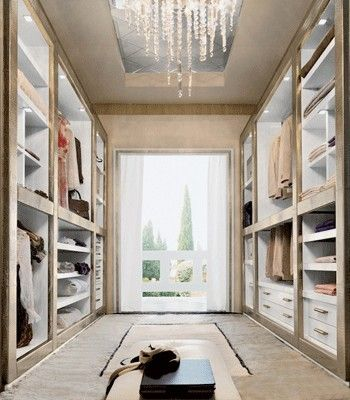 This walk-in wardrobe even has a chandelier!