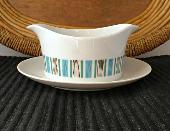 This is a vintage Scandinavian style gravy boat by Harmony House. The blue and green striped pattern is called Scandia. Use to serve gravy and sauces or even use it as a planter for small plants like succulents. The underplate is attached. Measurements: The underplate is about 7.5