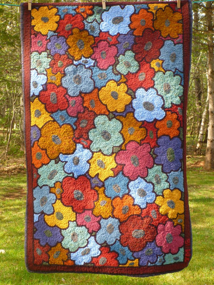 Pattern is 'Flowers Afoot' by Pastimes PEI Rughooking Shop. Hooked by Jean MacKie.