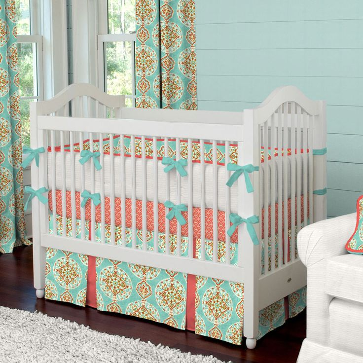 Coral and Aqua Medallion Crib Bedding | Carousel Designs. Sophisticated yet fun, our Coral and Aqua Medallion crib bedding is sure to be the hit of your nursery. The vibrant shade of coral accented with a touch of teal creates a look that will grow right along with your little one.