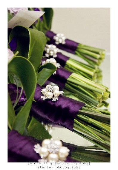 Beautiful eggplant bouquet wraps with pearl and rhinestone brooches by Love Is In The Air