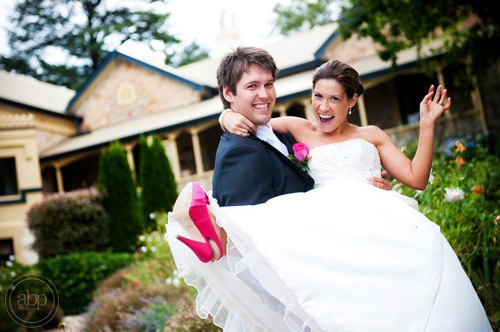 Great location for fabulous wedding pictures. We love the pink shoes!