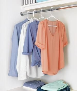 Hang a rod in the laundry room with a shelf overhead