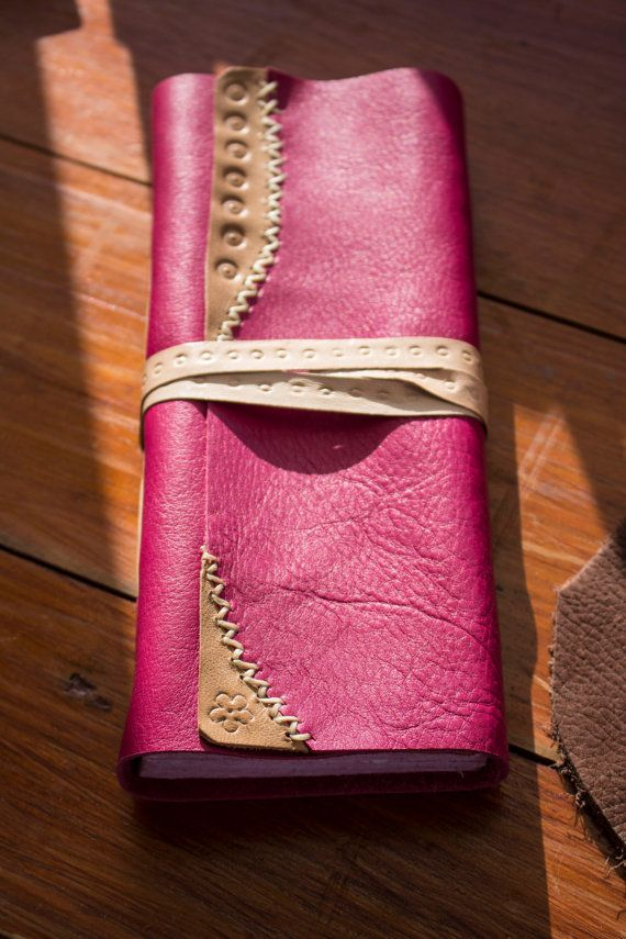 This lovely vertical leather journal is a very special repositorium for your deepest and magic feelings and words. I used a soft pink leather to cover it and some pieces of natural stamped leather with little lovely details.