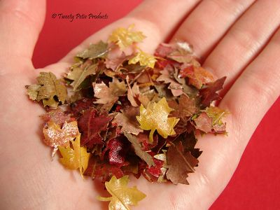 punch leaves from real leaves and coat them with a glaze like gallery glass to make them shiny and preserve them