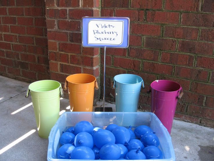 "Violet's Blueberry Squeeze - water balloons with pinholes, ready to be ""juiced""."
