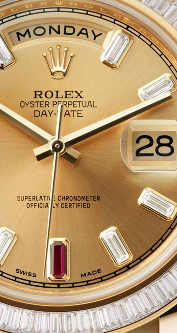 Lindsey Vonn's Rolex Day-Date 40, adorned with a diamond-set bezel and baguette-cut hour markers, with two, rich red rubies set at 6 and 9 o'clock.