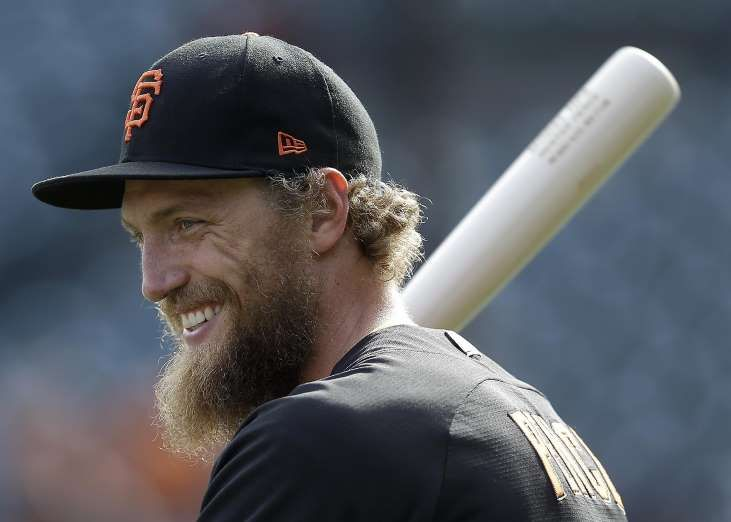 Giants-Dodgers tickets plunge to $6 after brutal start  -  April 24, 2017  San Francisco Giants right fielder Hunter Pence warms up before Game 4 of baseball's National League Division Series against the Chicago Cubs in San Francisco, Tuesday, Oct. 11, 2016. (AP Photo/Ben Margot)